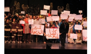 "Nayer Nagui, artistic director and principal conductor of the Cairo Opera Orchestra addresses the audience. Instead of performing the scheduled Verdi's Aida, the artists staged a protest opposing the minister's decision to remove Ines Abdel Dayem from the opera's chair and opposing the ""brotherhoodisation"" of the Egyptian culture. Tuesday 28 May 2013 (Photo: Ayman Hafez)"