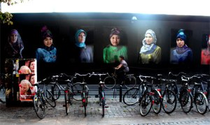 Hansen's 'A Scarf is A Scarf is A Scarf' photographs smile at passers-by in Copenhagen (photo: Ati Metwaly)