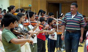 Osman El-Mahdy with his students, Suzuki method violin classes at the Talents Development Centre. (photo: Ati Metwaly, 2011)